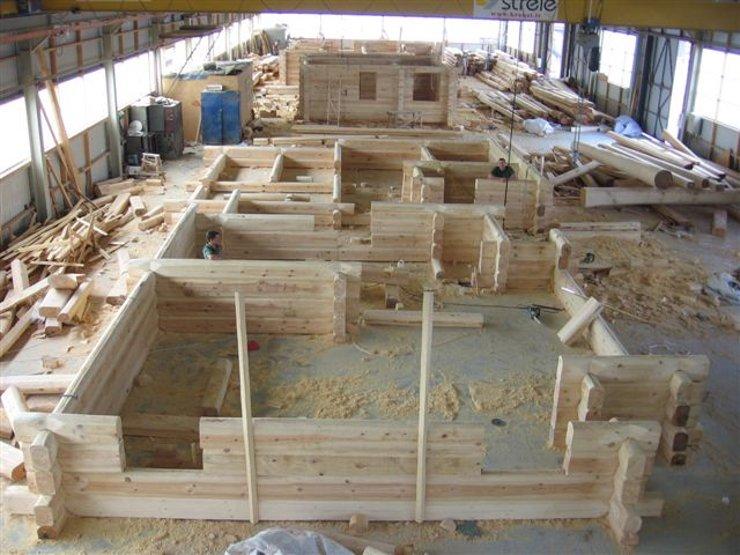 Case in legno lavorate a mano eco case in legno for Immagini di case rustiche